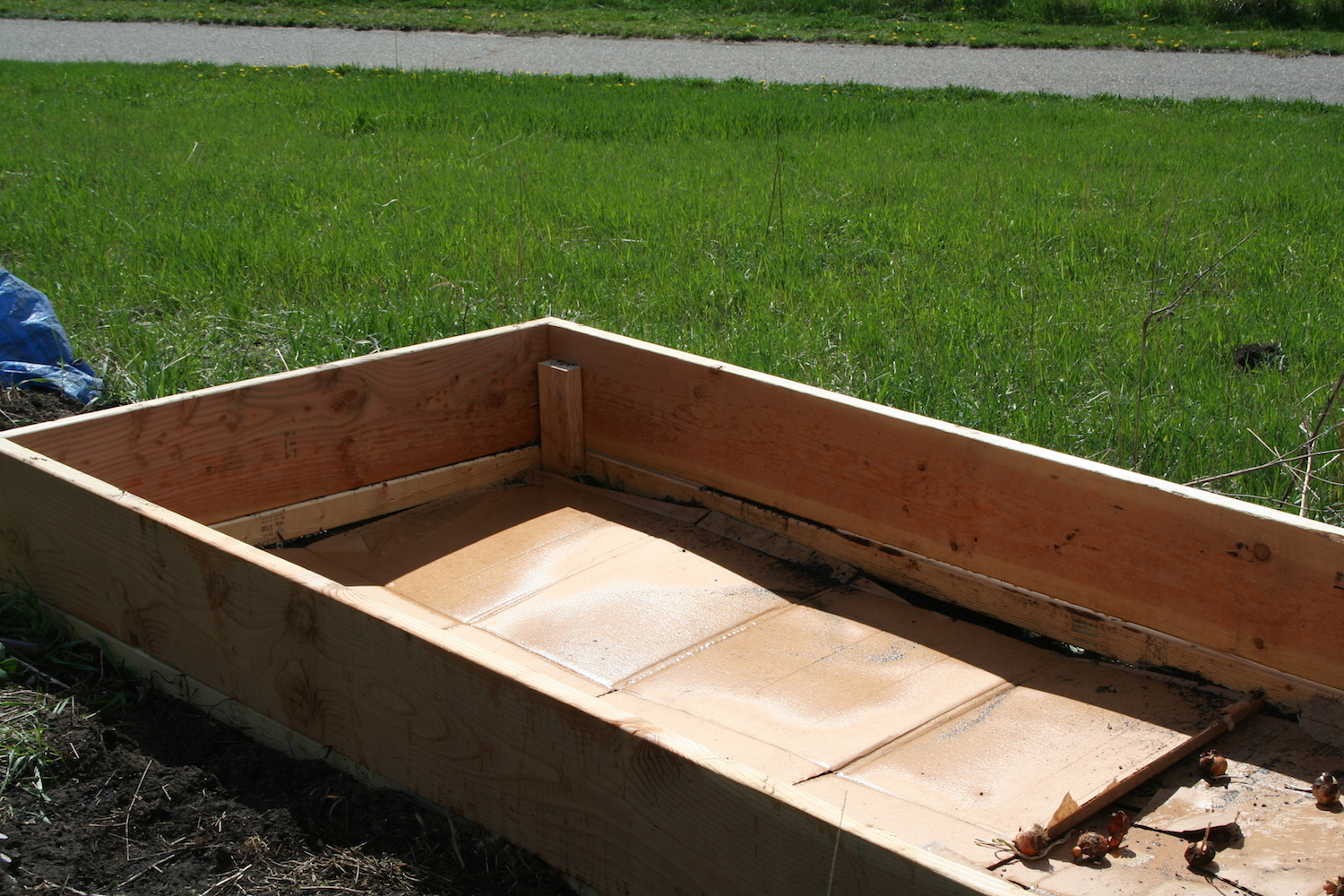 wooden raised bed with compost
