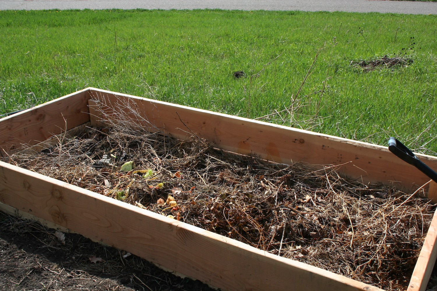 raised bed with decomposing plants