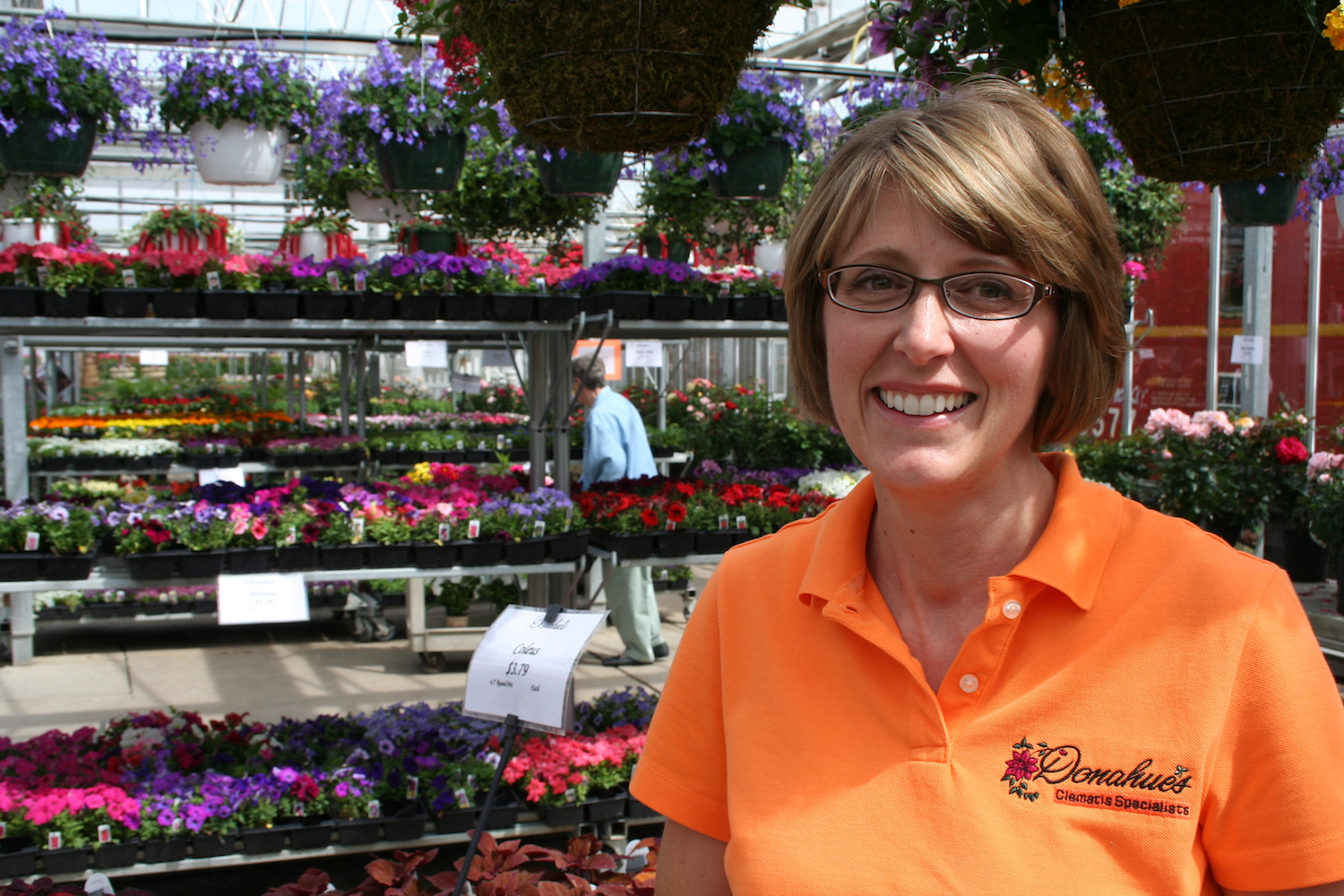 smiling woman in garden center