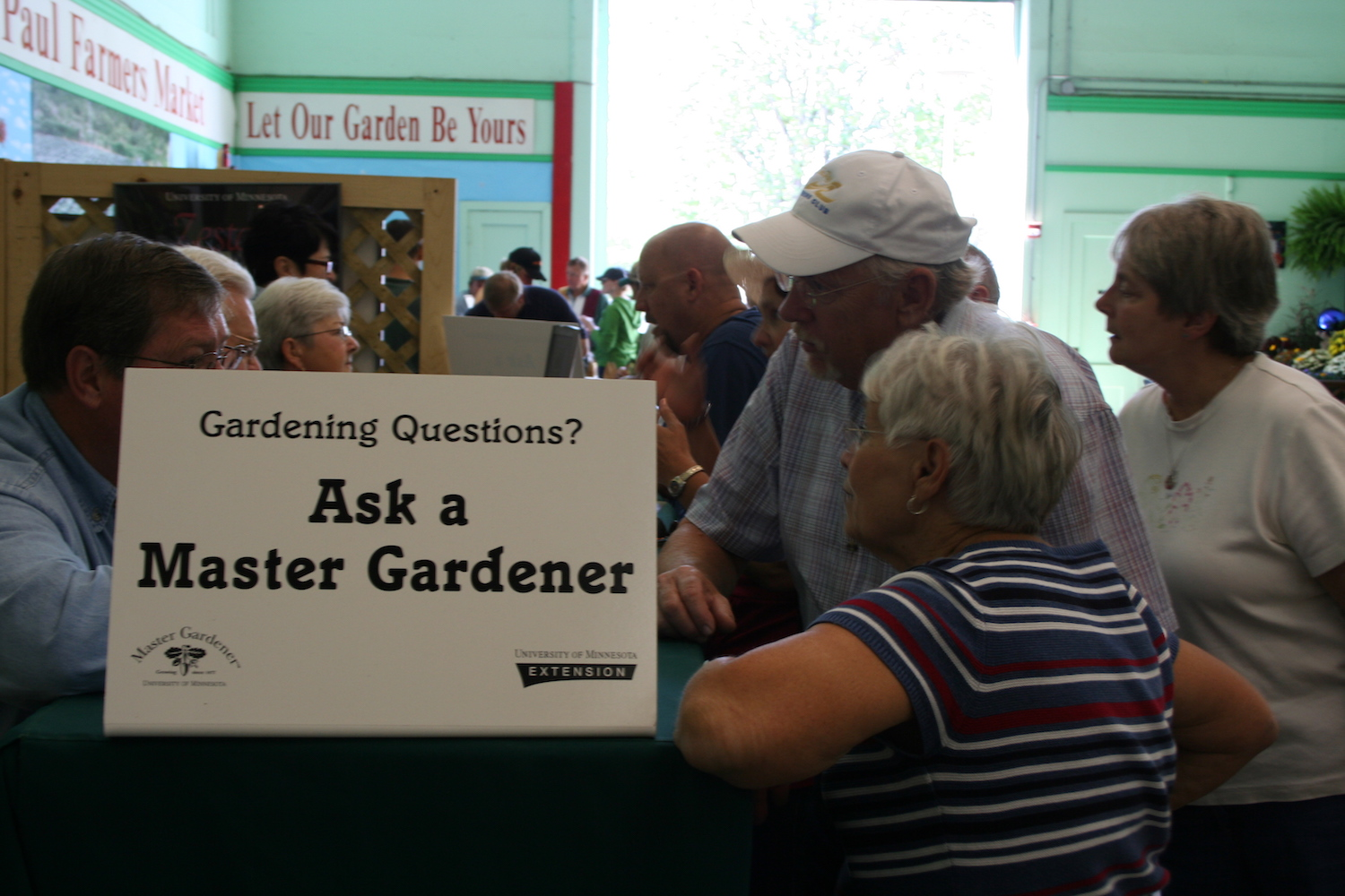 fairgoers with master gardener