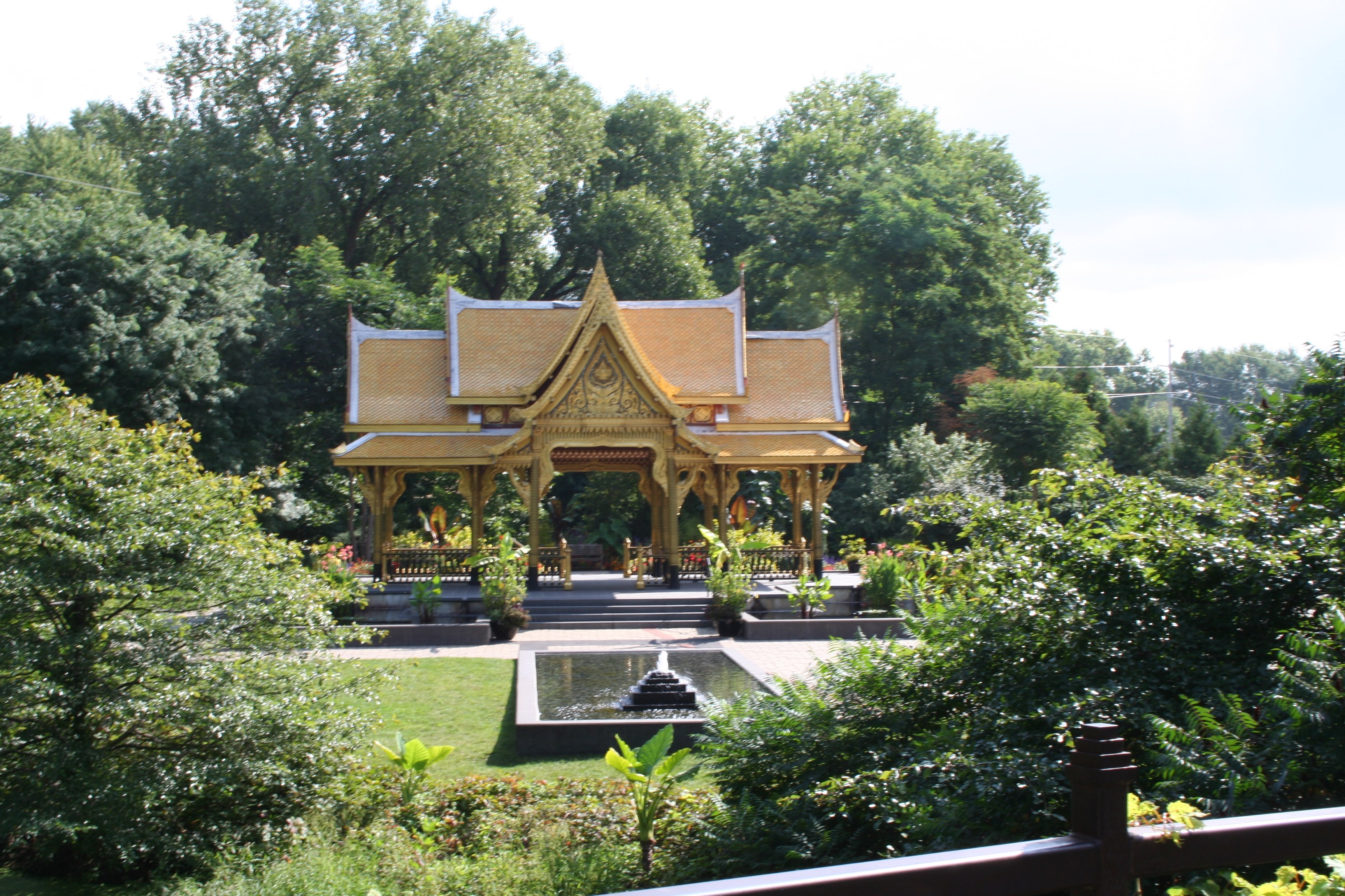 You Approach The Thai Pavilion Over A Bridge, But Get A Glimpse Of It  Through The Trees.