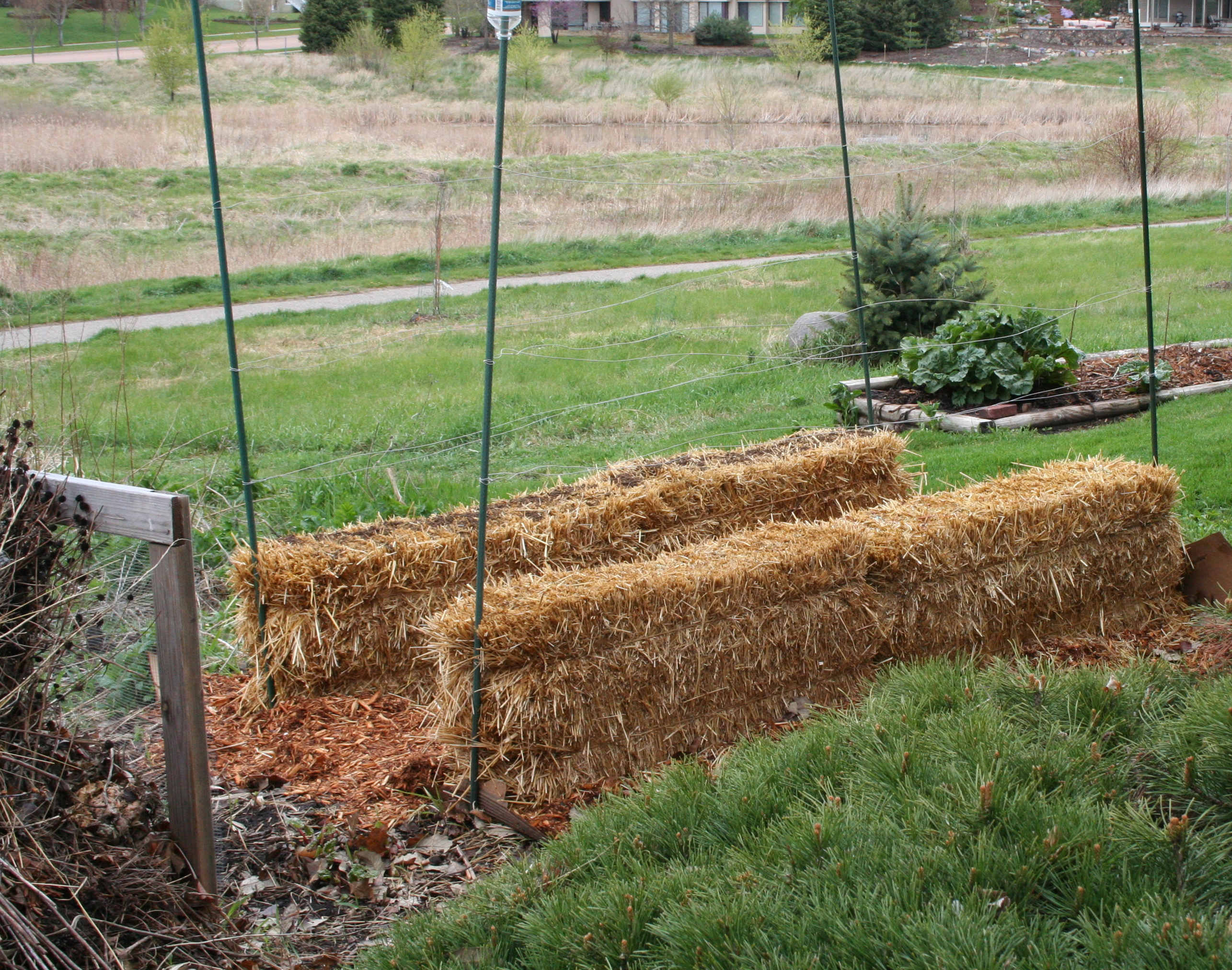 New straw bale garden my northern garden for Landscape gardeners