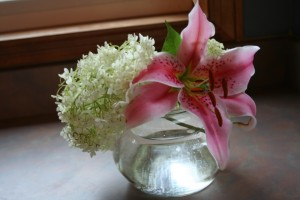 Lily and hydrangea in bowl