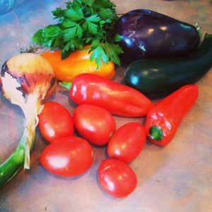 For a simple ratatouille, you'll need onions, zucchini, eggplant, peppers, garlic and herbs.